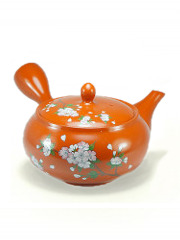 Orange teapot cherry flowers